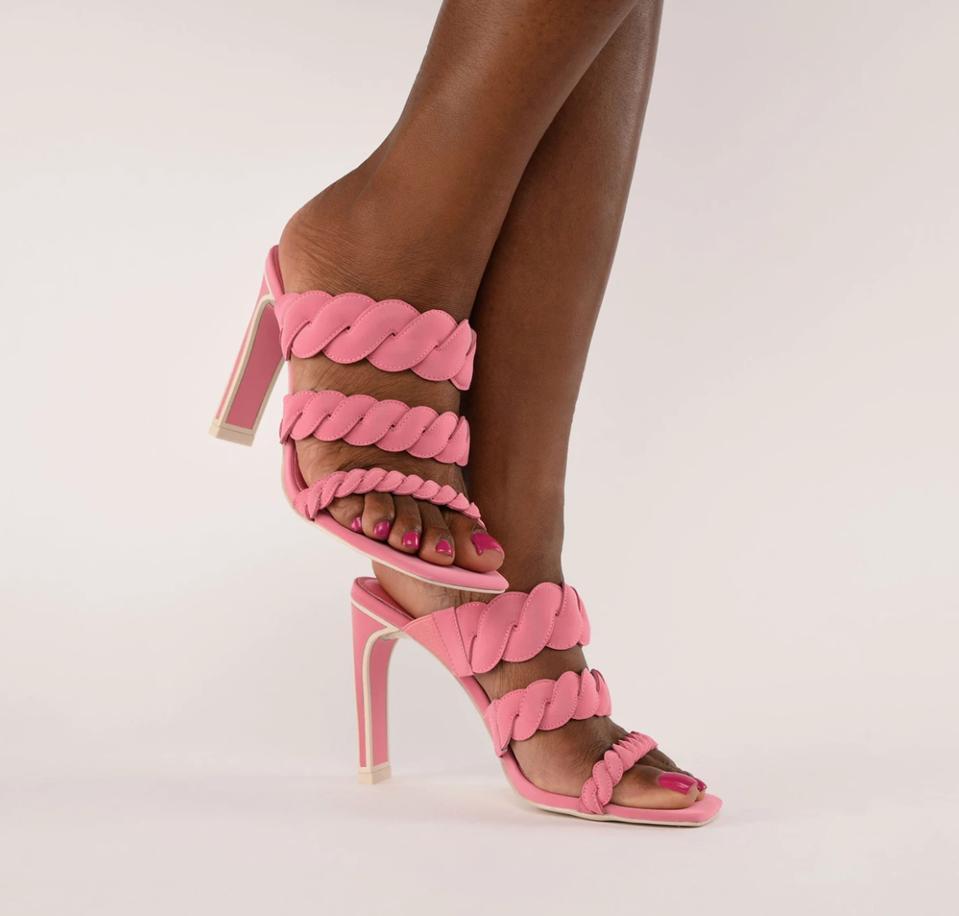 black model's legs wearing pink sandals