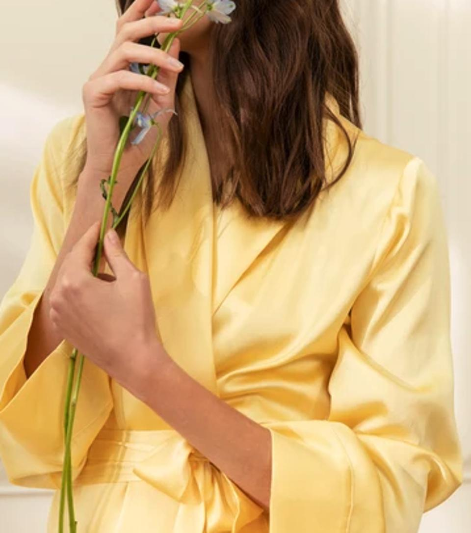 model wearing a yellow silk dressing gown