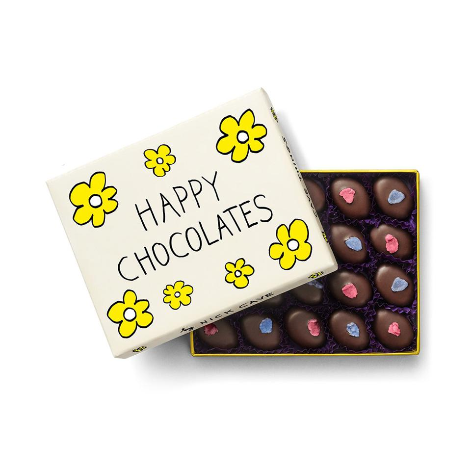 chocolates in box with yellow flowers