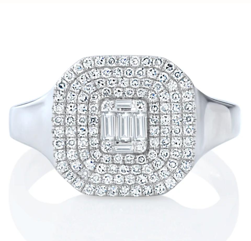 diamond ring with a square facetop in pave diamonds