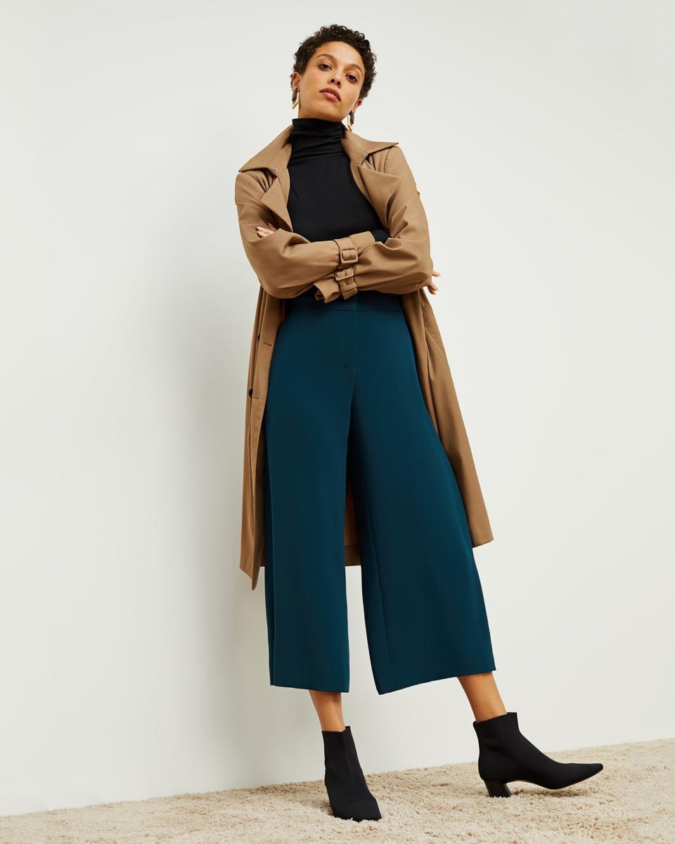 woman wearing trench coat