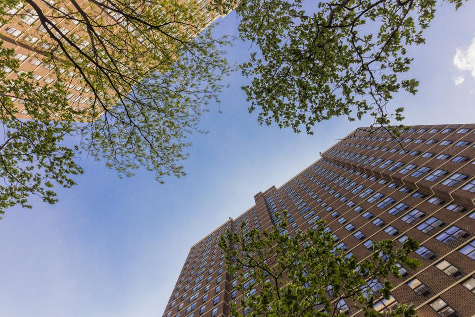 Two high rises as seen from the ground up