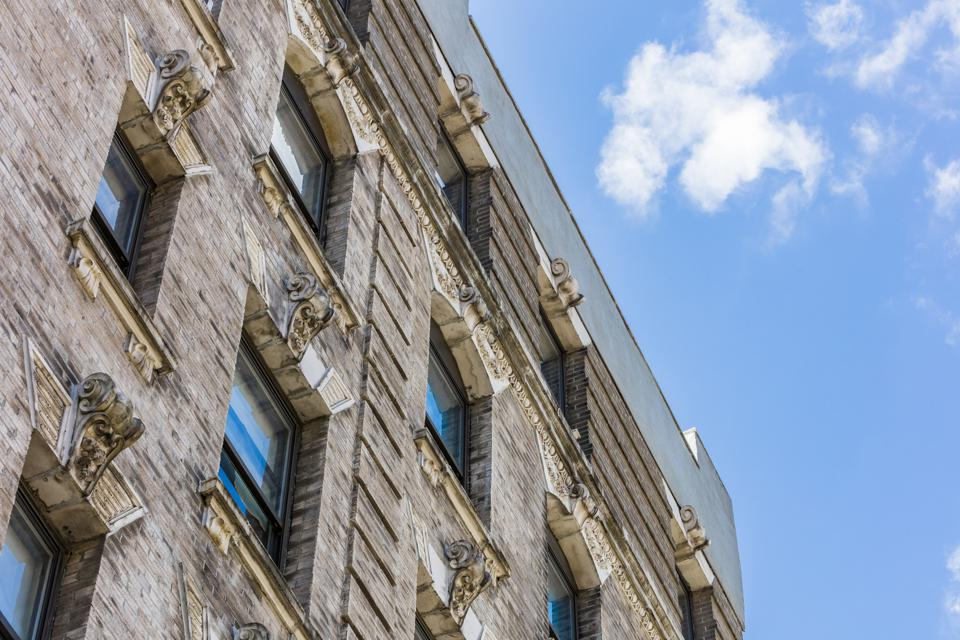 Windows and the top of a multifamily building in Lenox Hill