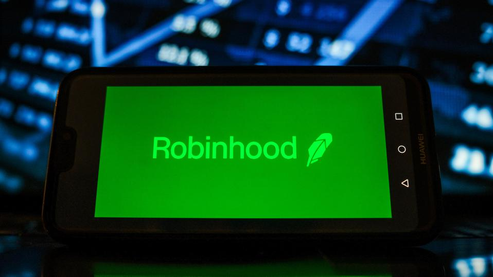In this photo illustration a Robinhood logo seen displayed...