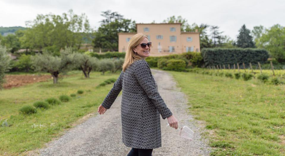 Wine importer Laine Boswell looks over her shoulder at a client wineries in France.
