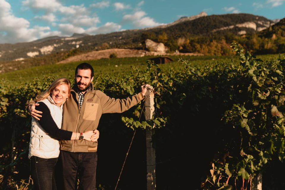 Laine Boswell and her husband, winemaker Olivier Roten, in his Swiss vineyard.