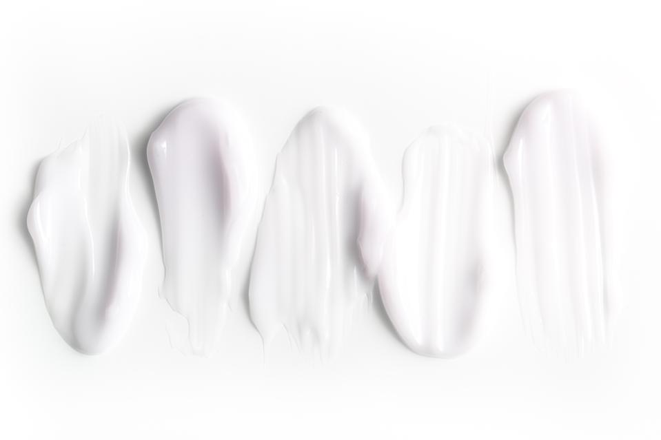 A group of textured strokes of moisturizers on a white background.