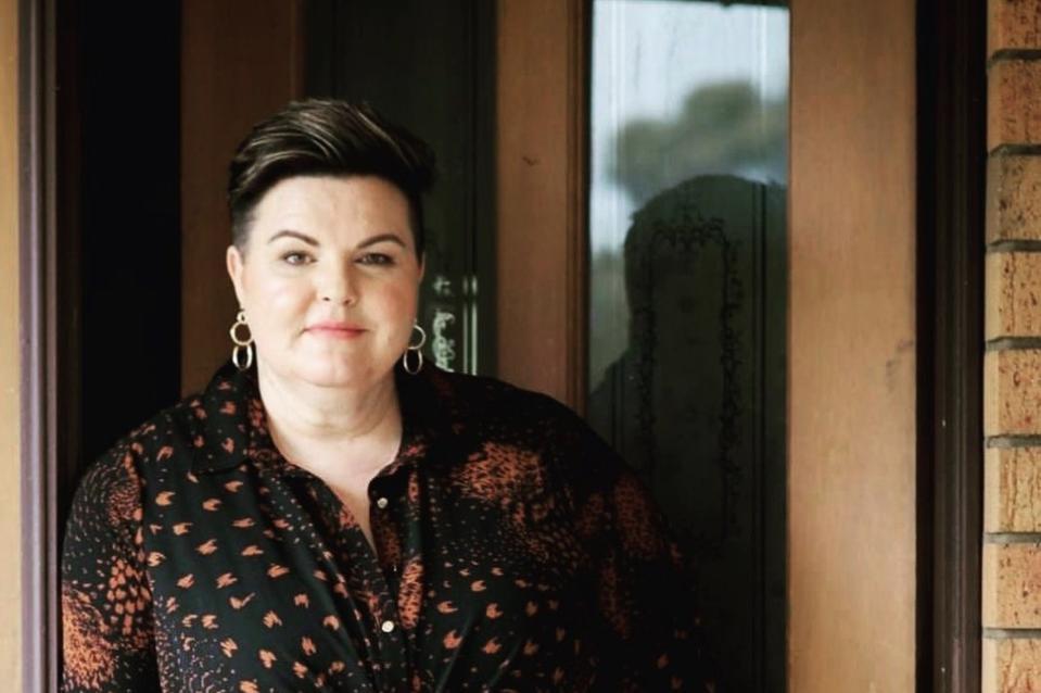 Kristy Forbes, standing in a doorway