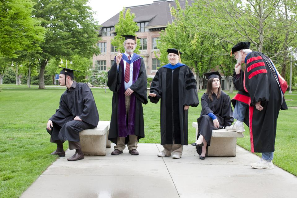 Professors and students waiting for graduation