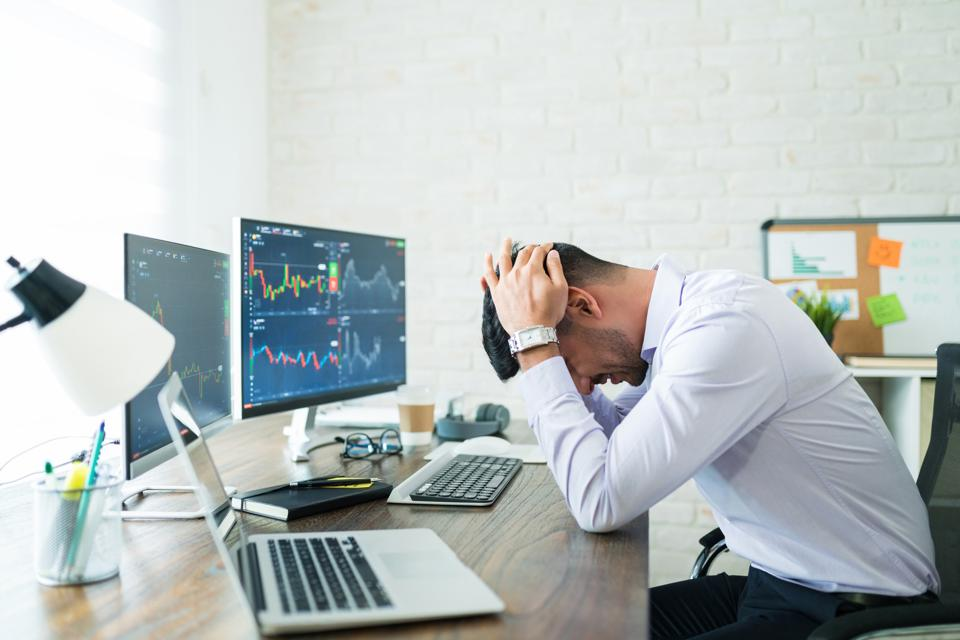 Male Finance Freelancer Exhausted With Work