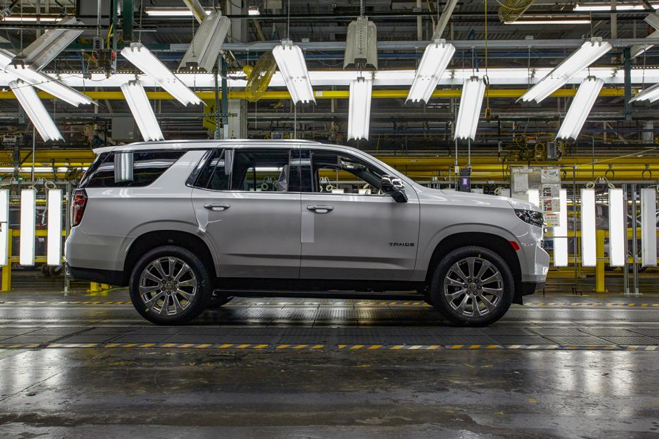 A silver, 2021 Chevrolet Tahoe SUV rolls off the assembly line.