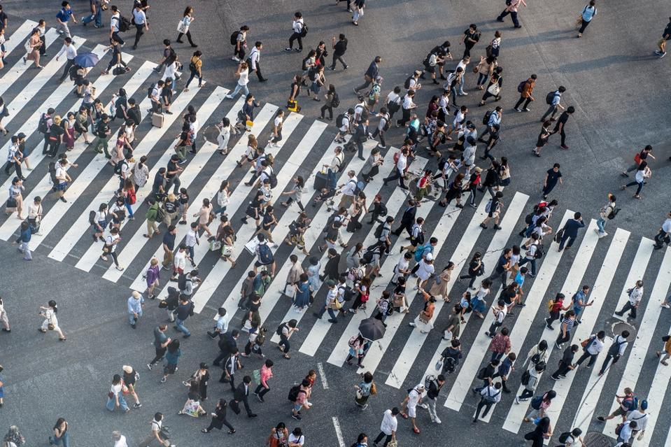 Group of people crossing the street on a crosswalk