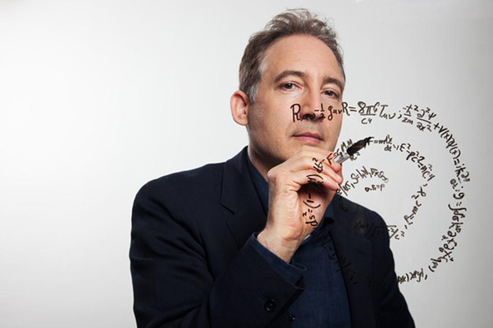 World-renowed scientist Brian Greene writing on the whiteboard.