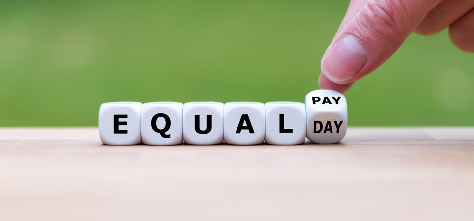 Symbol for the equal pay day. Dice form the expression ″EQUAL PAY DAY″.
