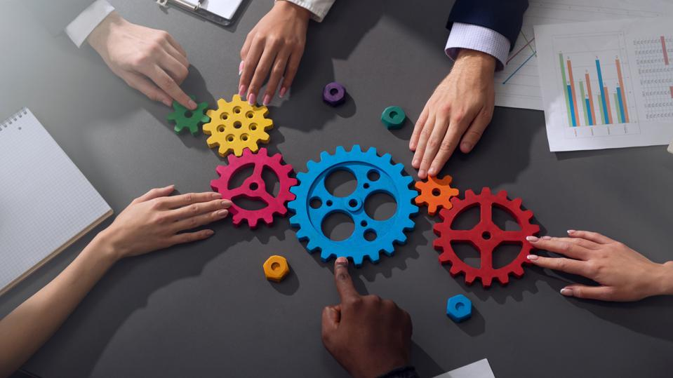 Business team connect pieces of gears - process to measure, track, and quantify return on investment