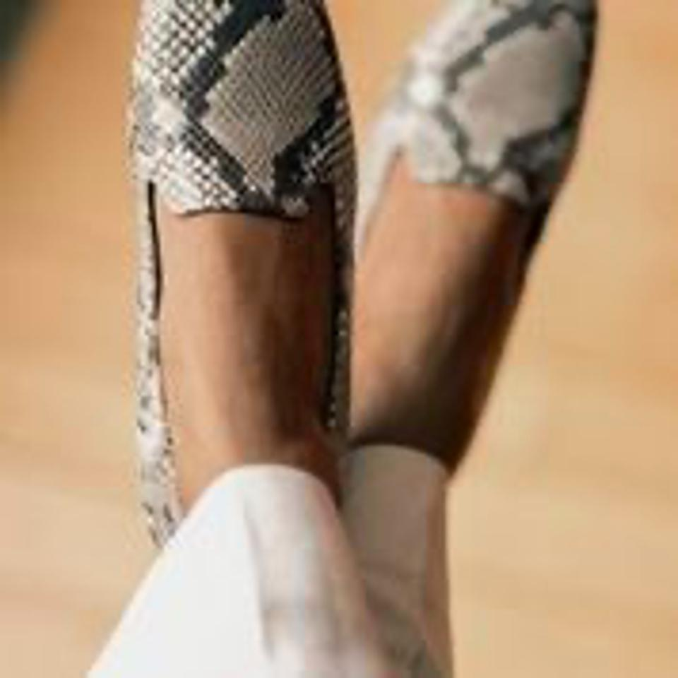 womens feet with shoes on them
