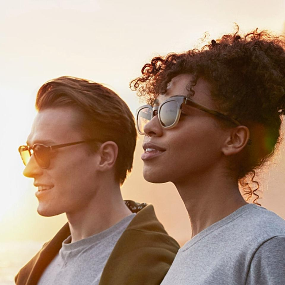 man and woman wearing sun glasses