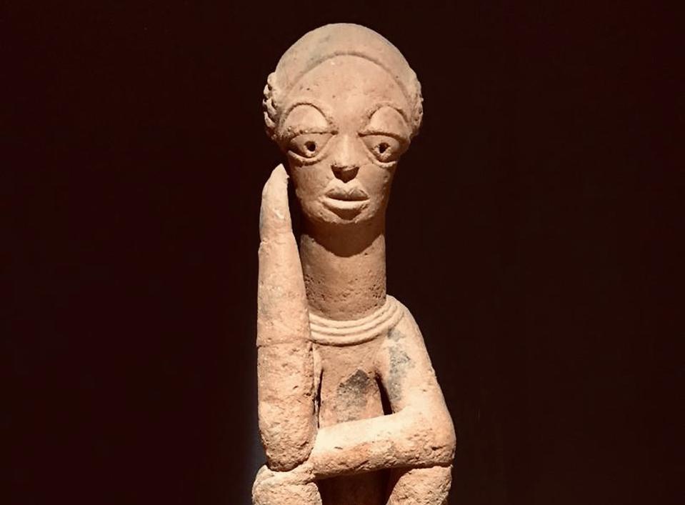 An ancient sculpture from Dakar's Museum of Black Civilizations depicting a pensive woman