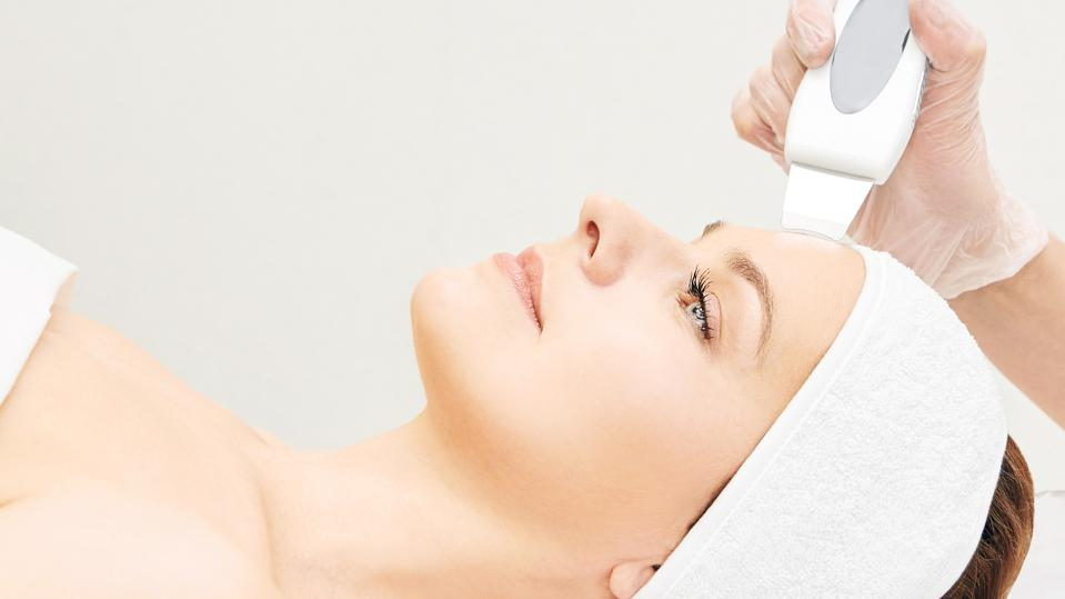 Ultrasinic cosmetology face equipment. Facial skin cleaning. Beauty female girl. Medical salon care machine