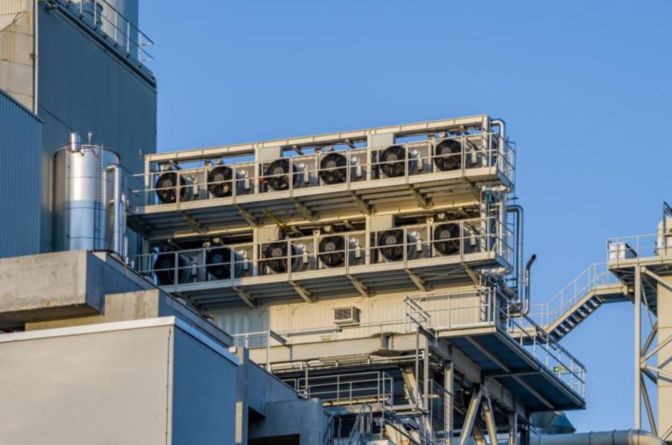 A carbon capture unit attached to an industrial facility.