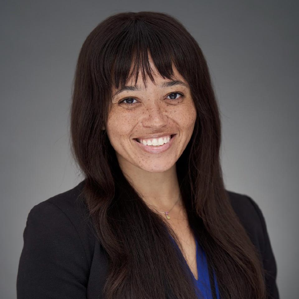 Headshot of Erin Adams smiling.