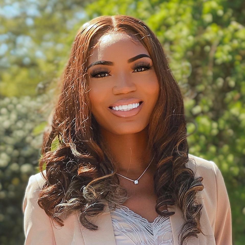 Headshot of Tasia Isbell smiling.