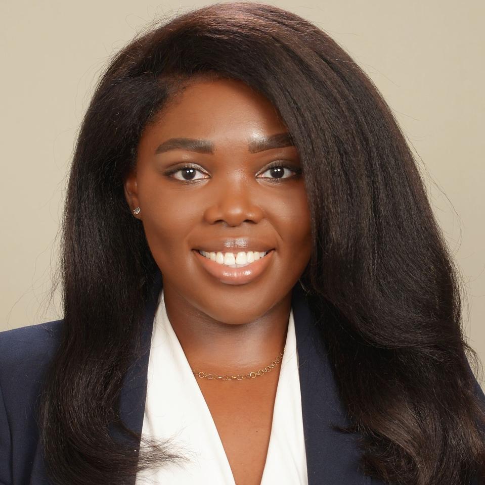 Headshot of Tracey Akanbi smiling.