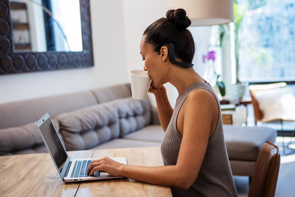 An image of a person drinking coffee at home using the Cove device.