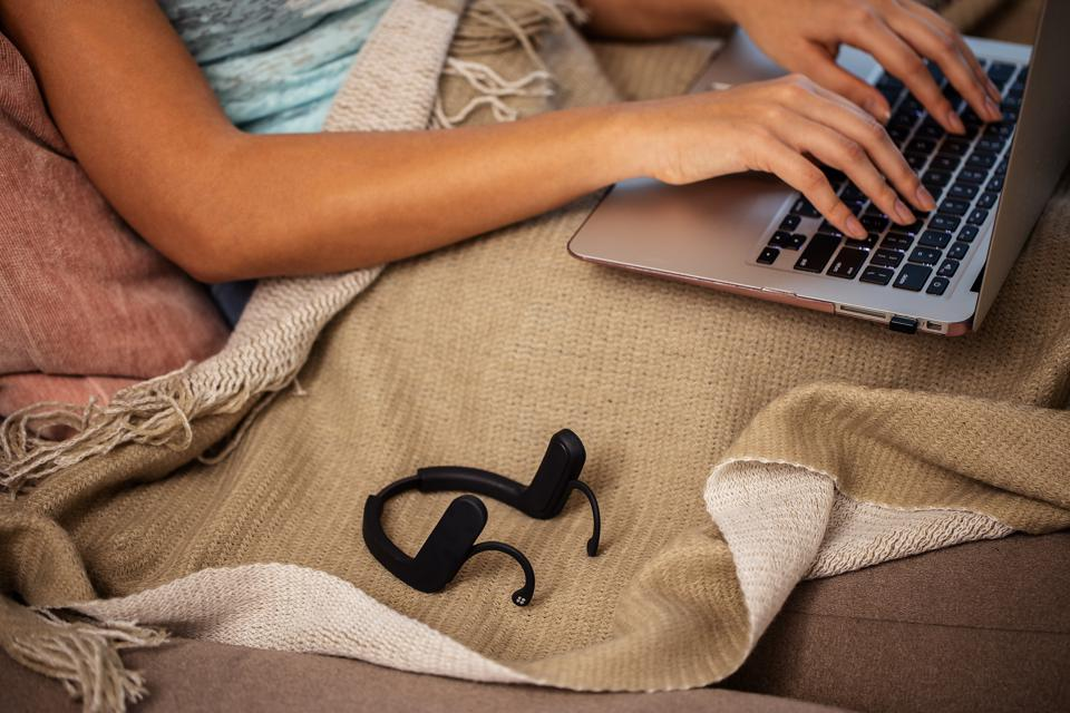 Product image of Cove next to a person typing on a laptop.