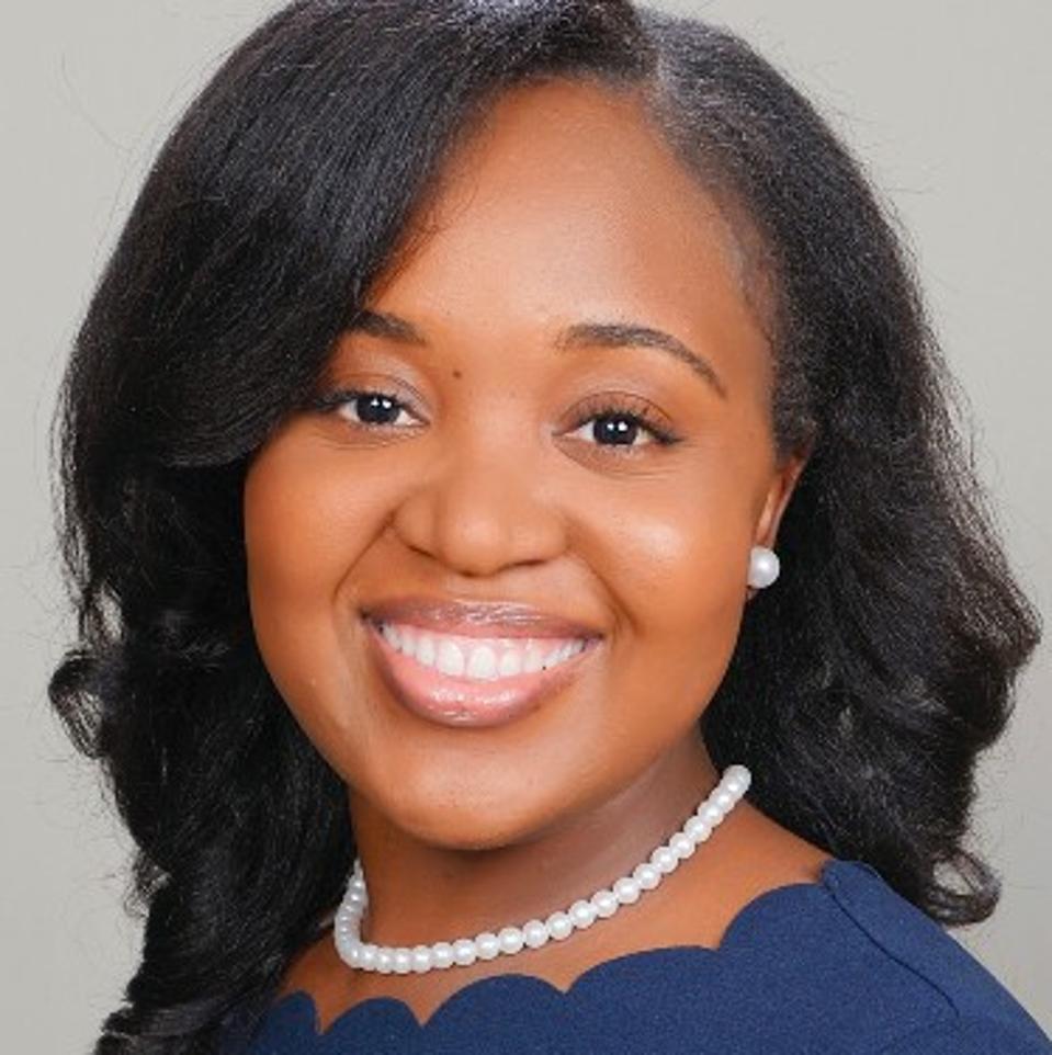 Headshot of Cherna Cherfrere smiling.