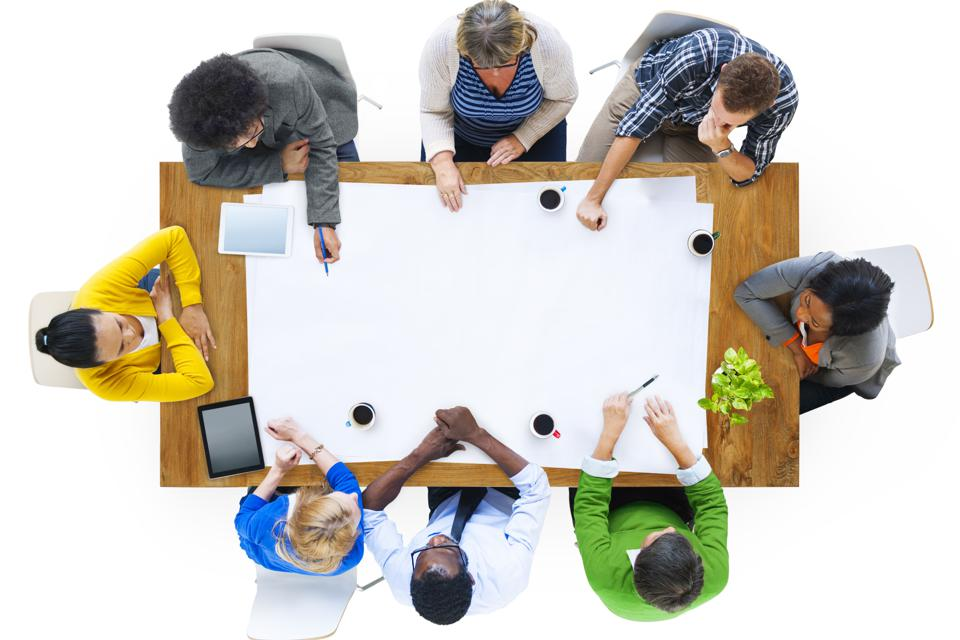 Overhead view of multi-ethnic people at table