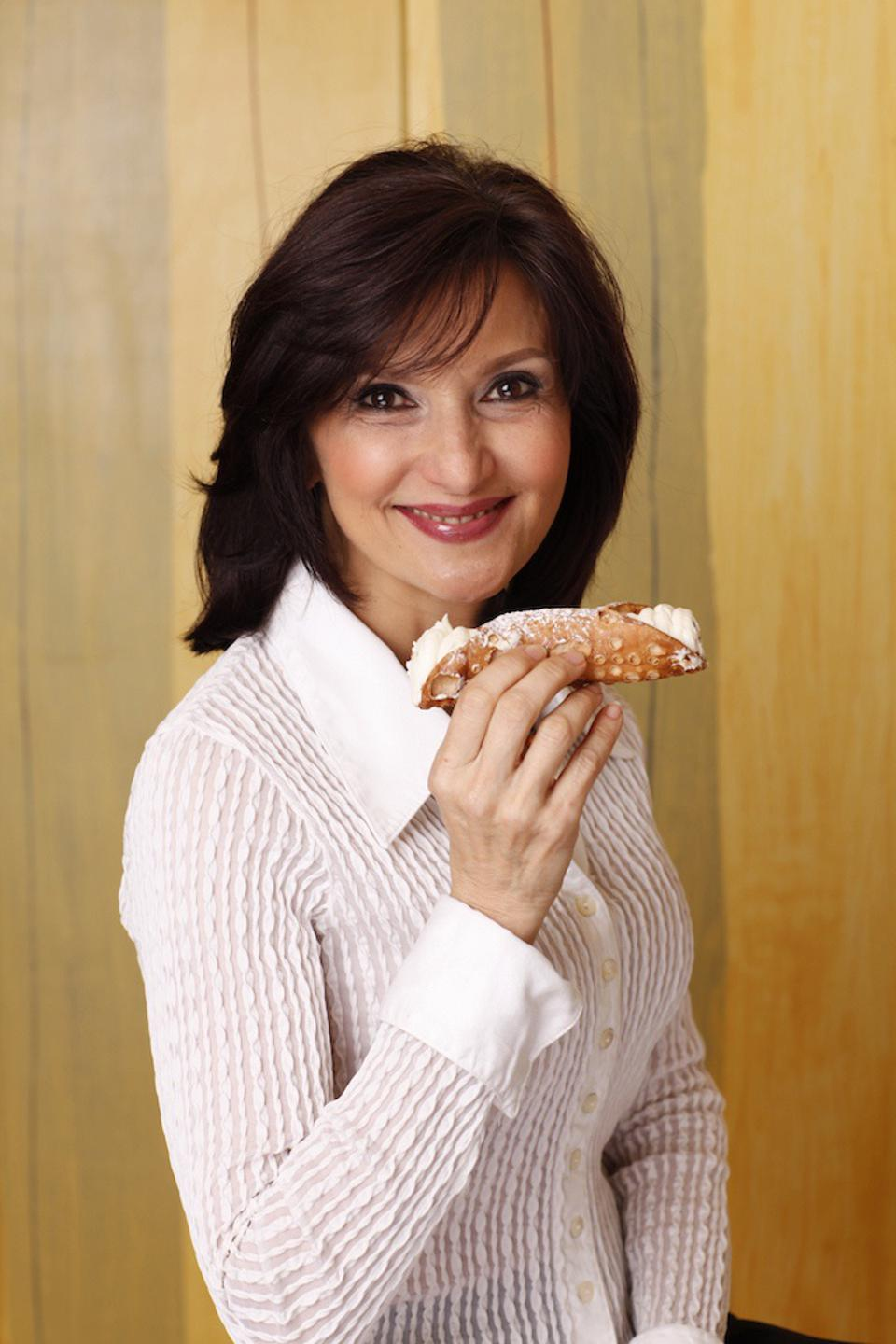 Francine Sagan with a Sicilian cannolli