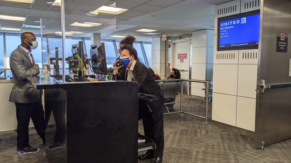 United Gate agents prepare to process passengers for boarding.