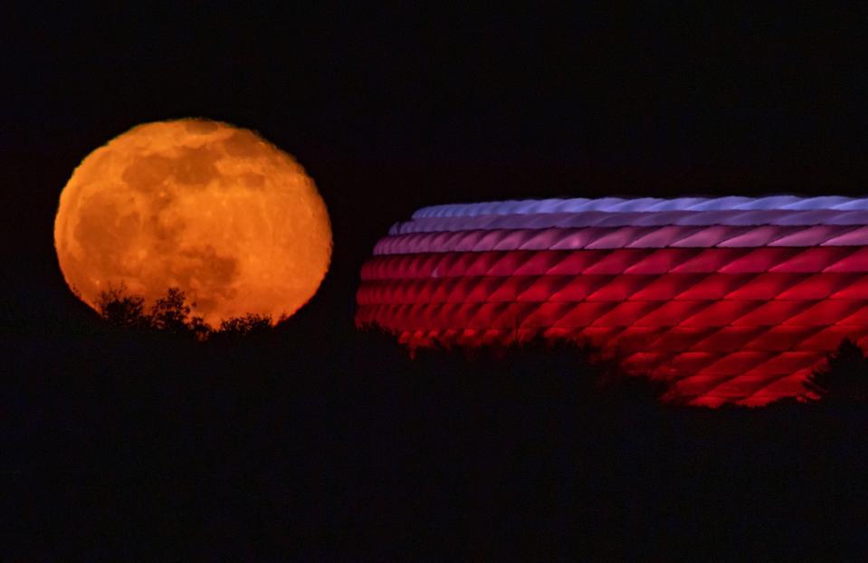 Moon behind Allianz Arena