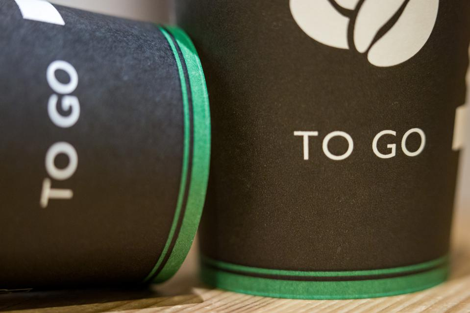 Two disposable coffee cups.