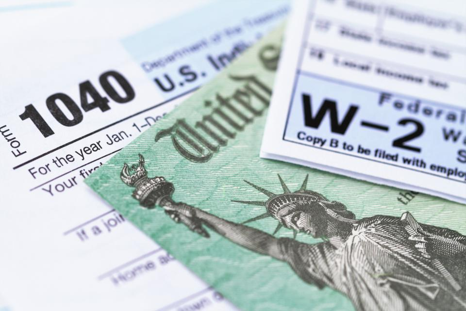 IRS tax forms with tax refund check