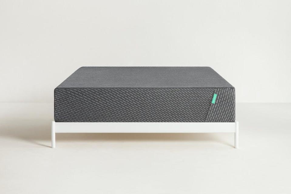 Tuft & Needle Mint mattress set up a white bed frame
