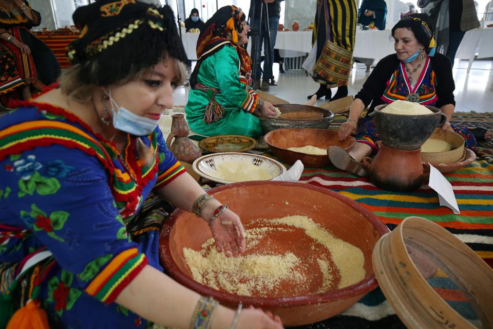 Kabyle women in traditional garb prepare Algerian Couscous Dish