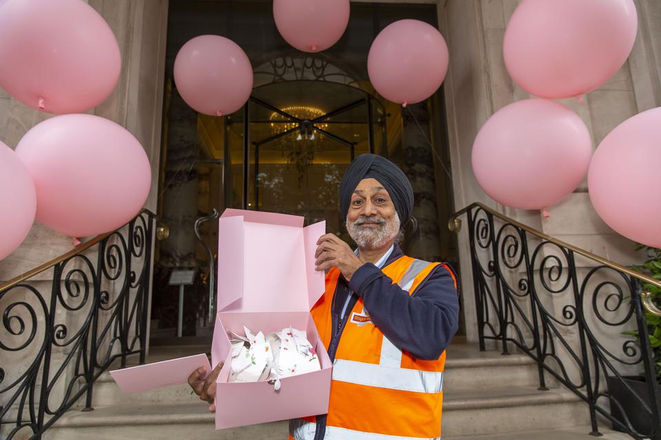 Postal worker outside the Langham Hotel in London
