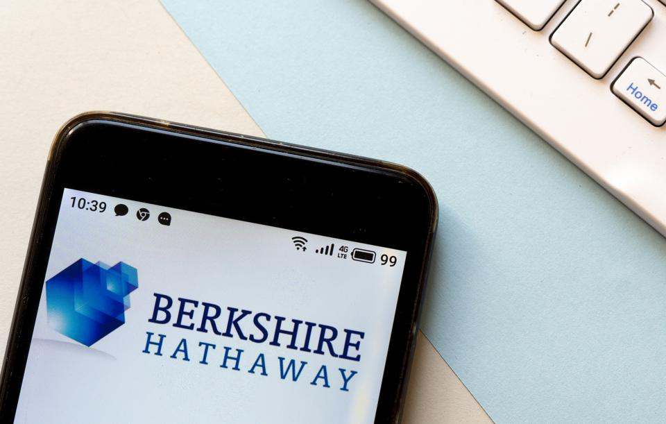 In this photo illustration a Berkshire Hathaway logo is seen...