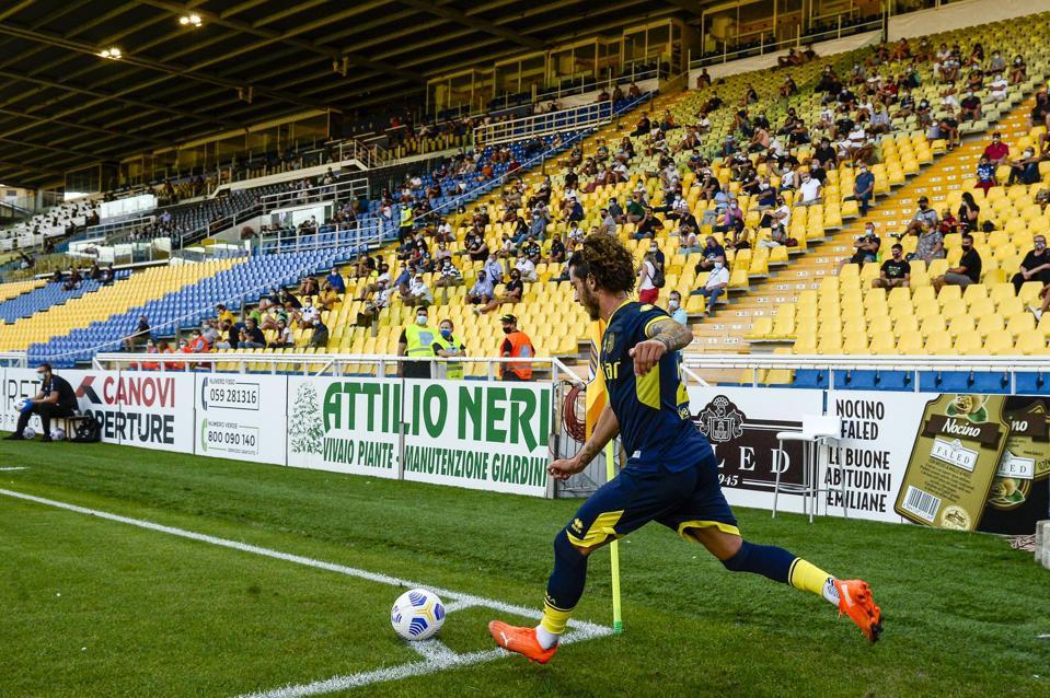 Jacopo Dezi of Parma Calcio kicks a corner kick as fans...
