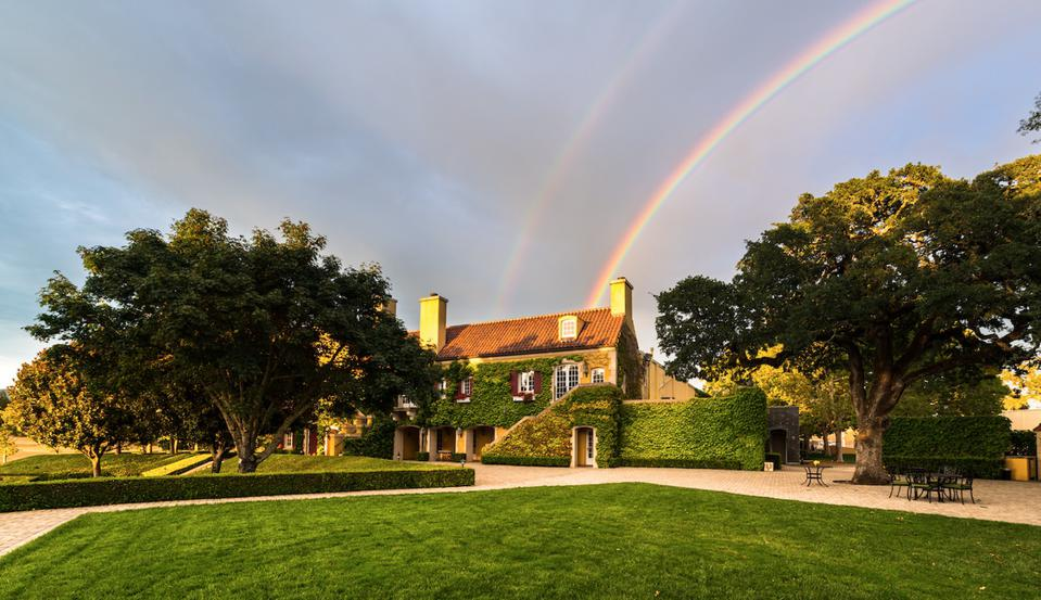 Jordan Vineyards & Winery Estate with a rainbow in the background