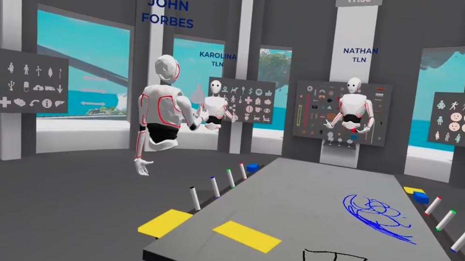 A scene inside a breakout room in TLN's Gemba technology. You can use tables, whiteboards, sticky notes, and more in a persistent environment.