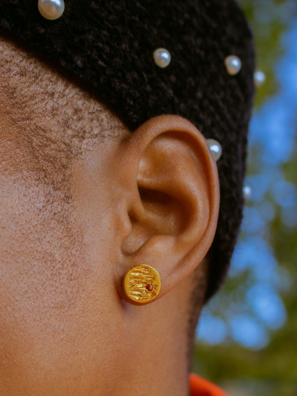 The Jupiter earrings by Kassandra Lauren Gordon, 18kt gold vermeil with red sapphires.