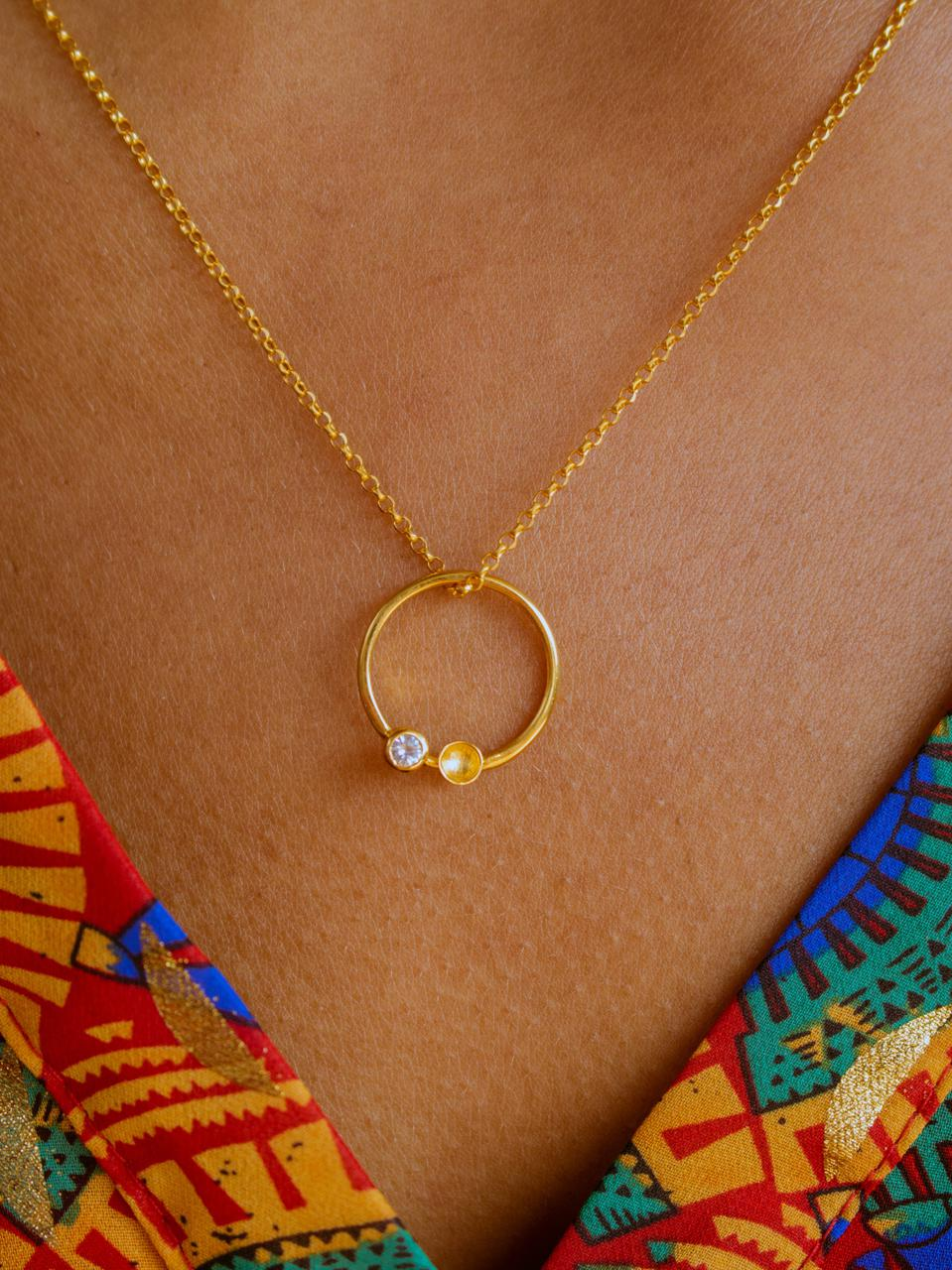 The Night Sky necklace by Kassandra Lauren Gordon, 22ct gold vermeil with white diamond cut sapphire stone