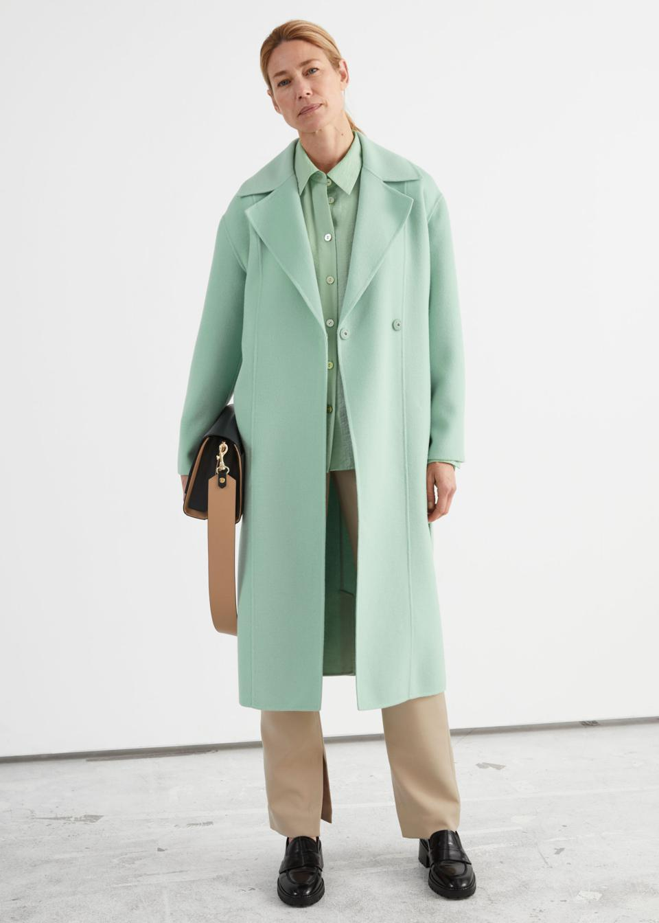 Woman wearing mint green coat
