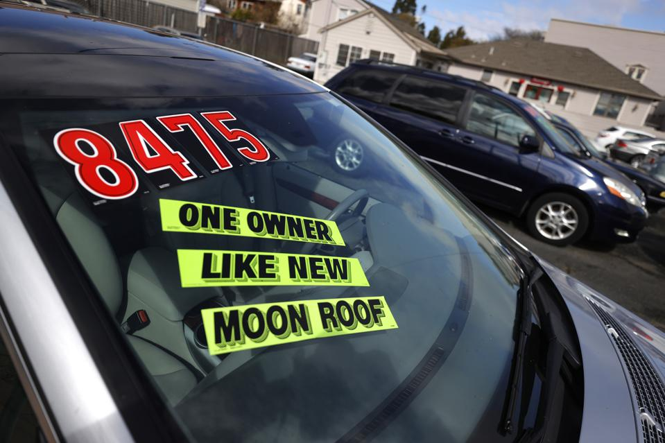 Signs on the windshield of a used car say it's ″like new.″