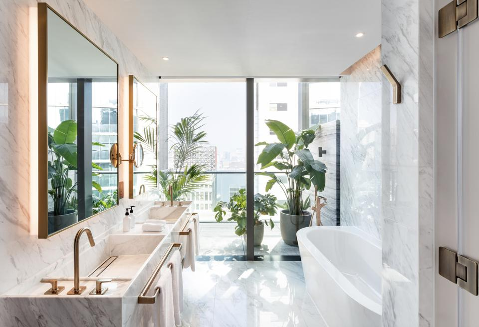 A bright marble bathroom in the hotel's Penthouse Suite.