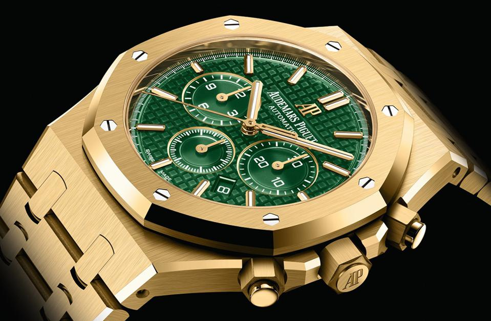 The Audemars Piguet Royal Oak yellow gold chronograph with green tapisserie dial.