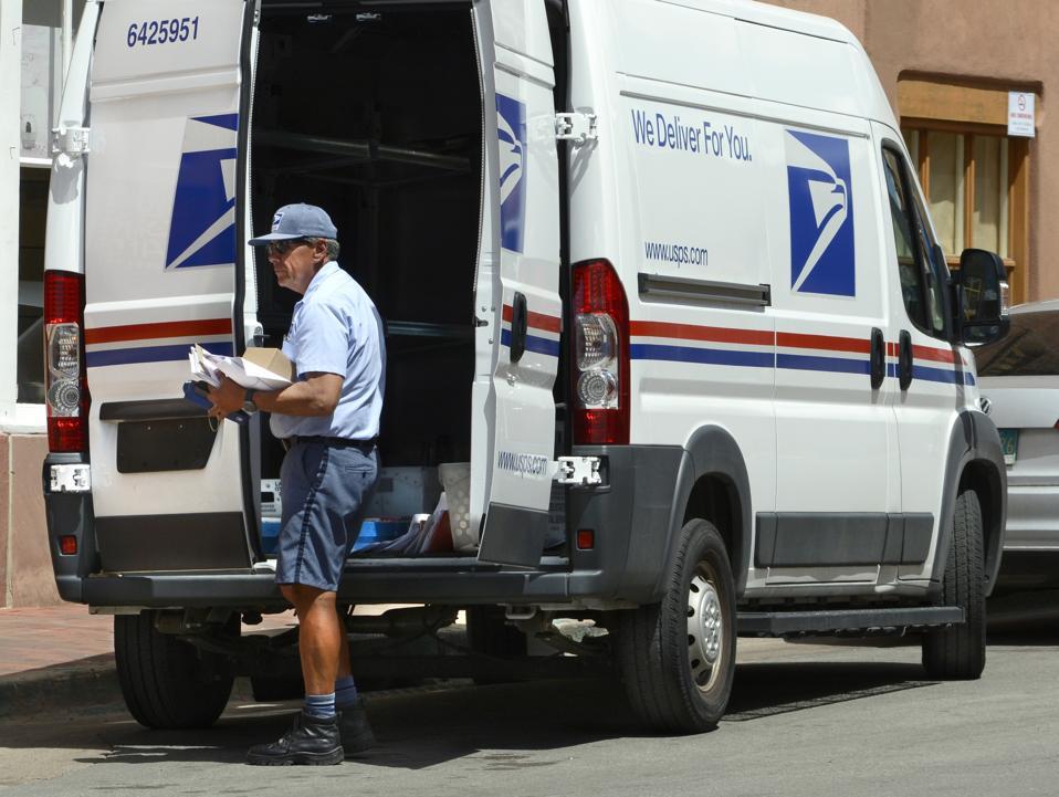 U.S. postman delivers mail